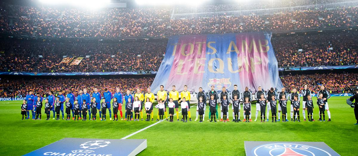 The teams line up ahead of the match