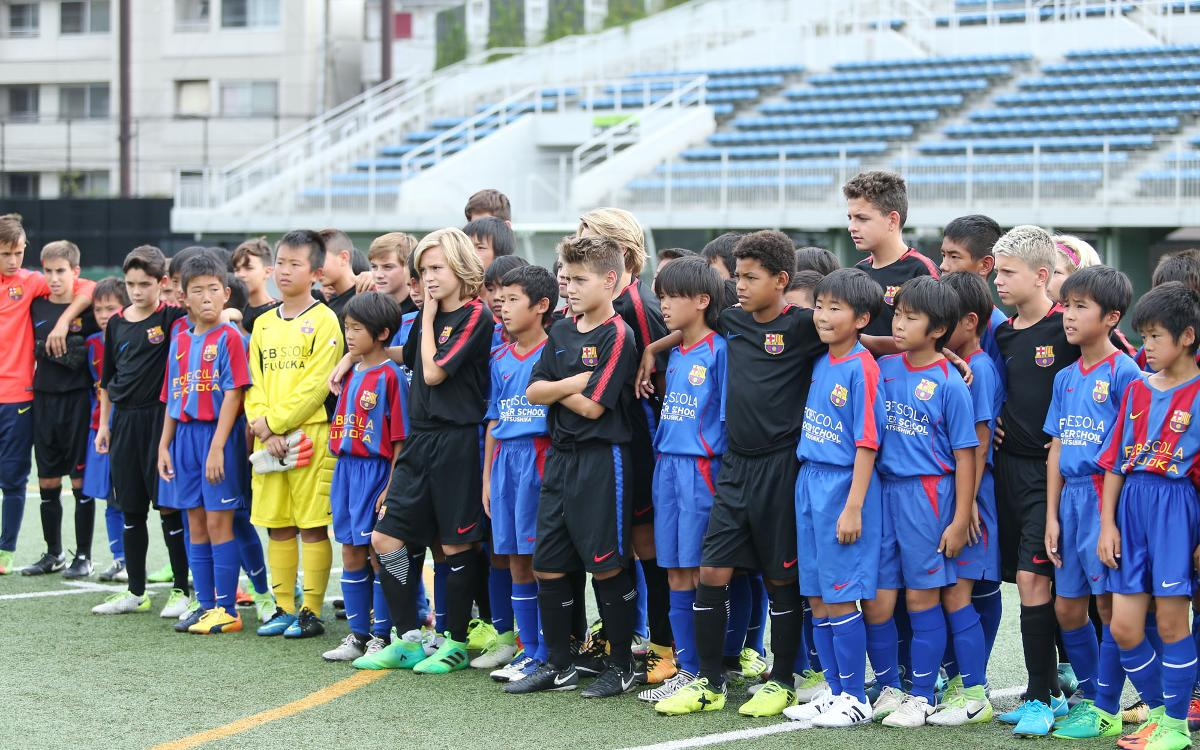 The Katsushika and Fukuoka FCBEscolas, with Barça's U13B team