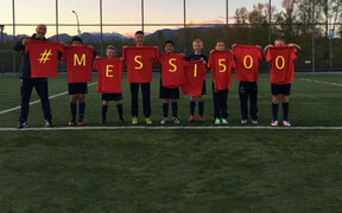 FCBEscola players from around the world congratulate Messi on his 500th goal